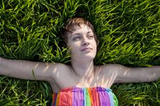 Free Young Woman Lying On Grass Stock Photo - 19340310