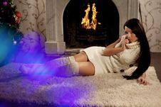 Free Girl Lying Near The Fireplace Stock Photography - 19340312
