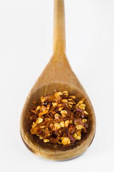 Pepper In Wooden Spoon Royalty Free Stock Photos
