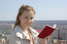 Free Female Reading A Red Book Stock Photo - 19343040