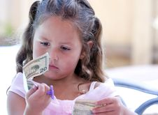 Free Child Looking At Money Royalty Free Stock Photos - 19344618