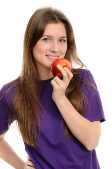 Free Young Woman Holding A Red Apple Royalty Free Stock Image - 19345656