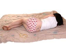 Free Girl Lying On Comforter. Stock Photos - 19349253