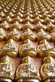 Many Small Buddha Statue (Vertical) Royalty Free Stock Image