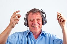 Free Man Enjoys Music Royalty Free Stock Photography - 19351297
