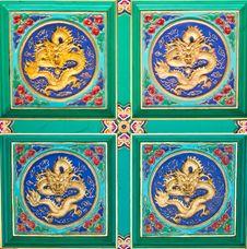 Wallpaper Of Golden Dragons Sculpture Stock Image