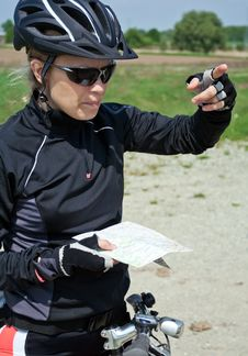 Free Woman On Bicycle Checking A Map Stock Images - 19354534