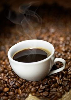Coffee Cup With Roasted Beans Stock Images