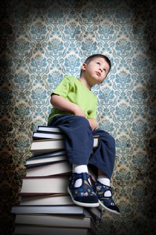 Free Small Boy Sitting On Books Stock Images - 19359564