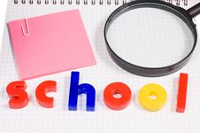 Free Magnifier On A School Writing-book Royalty Free Stock Photography - 19359887