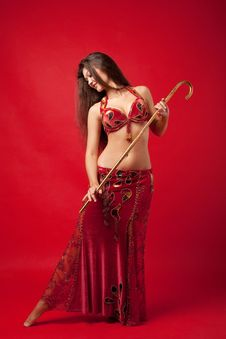 Free Young Woman Dance With Cane In Red Arabic Costume Stock Photography - 19359942