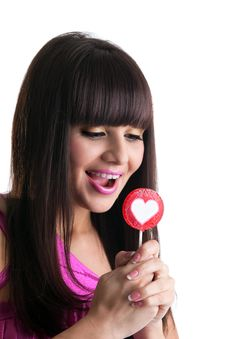 Free Young Brunette Woman Look At Heart Lollipop Royalty Free Stock Photos - 19359958