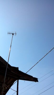 Antennae Towered Over The Rooftops Stock Image