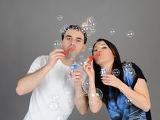 Free Pretty Couple In Love Blowing Bubbles Stock Images - 19361184