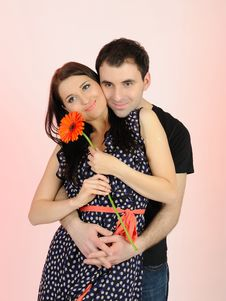 Lovely Romantic Man Giving Flower To A Woman Stock Photo