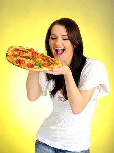 Pretty Young Casual Girl With Tasty Pizza Royalty Free Stock Images