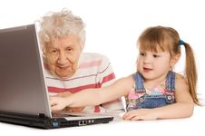 Grandmother With Grand Daughter At The Computer Royalty Free Stock Images