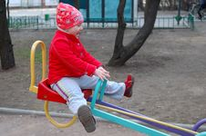 Free Little Girl On Seesaw (teeter-totter). Stock Photography - 19364312