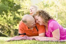 Free Affectionate Couple With Son In Park Royalty Free Stock Image - 19365606
