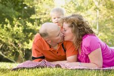 Free Affectionate Couple Kiss As Cute Son Looks On Stock Photos - 19365613
