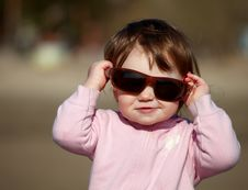 The Image Of A Little Girl In  Sunglasses Stock Photo