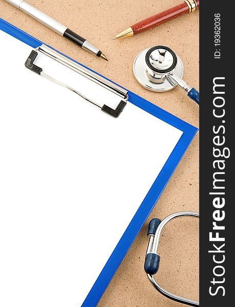 Medical stethoscope with form blank on wood