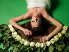 Free Girl Lay Among The Flowers Of Roses Stock Photo - 19370200