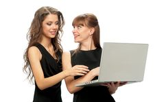Free Two Women Working On A Laptop Royalty Free Stock Photos - 19370728