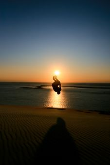 Silhouette Of Man Jumping In Sunset Royalty Free Stock Photos