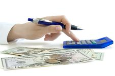 Hand With Pen Counting On The Calculator And Dolla Royalty Free Stock Image