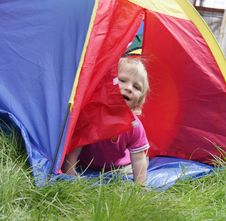 Free Child Sitting Inside Colorful Tent Stock Photos - 19376053