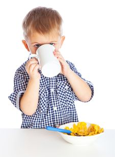 Free A Boy Is Eating Cereal From A Bowl Royalty Free Stock Images - 19378099