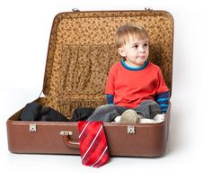 A Funny Boy In A Suitcase Stock Image