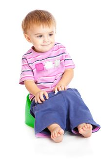 A Boy Sitting On The Pot Stock Photography