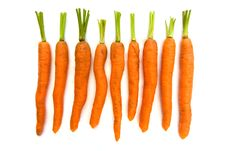 Free Line Of Carrots Over White Royalty Free Stock Photography - 19388807