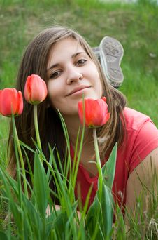 Young Girl And Tulips Stock Images
