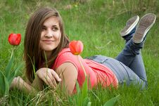Young Girl And Tulips Stock Photography