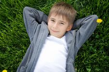 Free Boy On The Green Grass Royalty Free Stock Images - 19389519