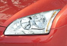 Free Close Up Of A New Car Headlight Royalty Free Stock Images - 19392669