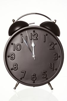 Alarm Clock Showing Five Minutes To Twelve. Royalty Free Stock Images