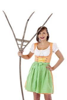 Free Beautiful Woman With Dirndl Holds Pitchfork Royalty Free Stock Photo - 19397315