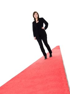 Free Smiling Girl Walking On Red Carpet Stock Photography - 19397572