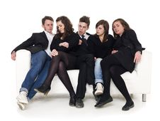 Group Of People In A Sofa Royalty Free Stock Photography