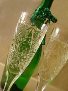 Free Close-up View Of Champagne Glasses With Bottle On Golden Backgro Royalty Free Stock Images - 1940269