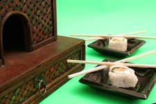 Free Smoked Salmon Sushi Rolls W/chopsticks Stock Images - 1940974