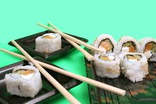 Free Salmon Sushi Rolls With Chopsticks Royalty Free Stock Images - 1941039