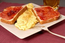Omelette With Toast, Strawberry Jam And Apple Juice Stock Image