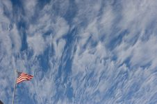 Free Torn Flag With Clouds Stock Photos - 1947593