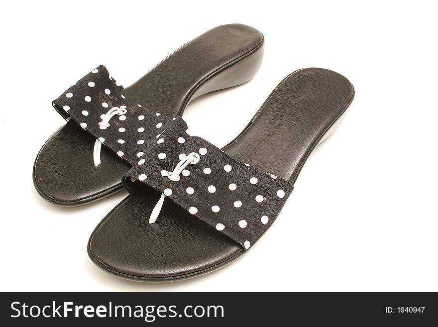 Polka dot shoes on white