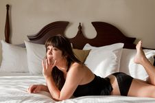 Happy Pretty Woman On Bed Stock Images